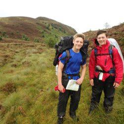 DofE - two male participants in Peak District, smiling, smiley