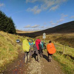 Walking towards blue skies on Gold DofE expedition in the Brecon Beacons